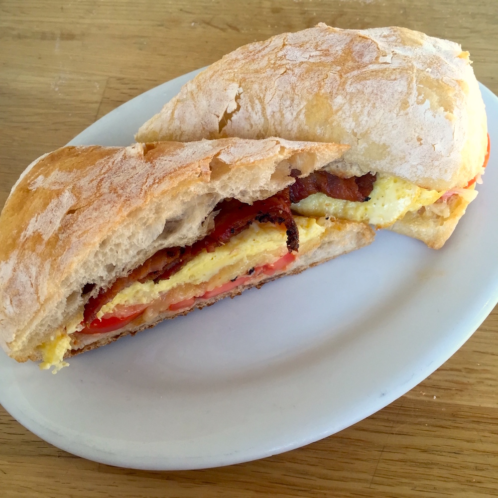 Bacon, Cheddar, and tomato egg sandwich