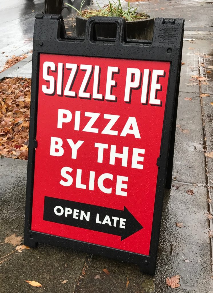 Sizzle Pie's sandwich board